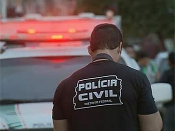 Policial civil atende ocorrência de homicídio no Distrito Federal.(Imagem:TV Globo/Reprodução)